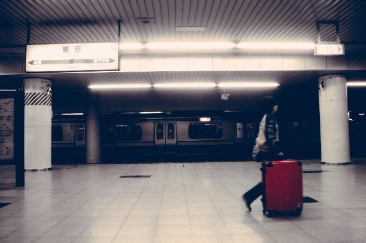 Woman Walking with a Bag